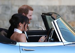 The newly married Duke and Duchess of Sussex, Meghan Markle and Prince Harry, leaving Windsor Castle after their wedding to attend an evening reception at Frogmore House, hosted by the Prince of Wales. The bride wore a ring which belonged to Diana, Princess of Wales.