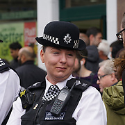 London,England,UK.9th April 2017. A police wiping during Stand for Keith cortege procession for funeral of PC Keith Palmer at Southwark street,London,UK. by See Li