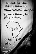 "A graffiti on the wall of the center shows a poem dedicated by one of its residents to his original country, Central African Republic with an illustration of the continent and the country: "" life is worthless, as nothing worth living, you have nothing, you are nothing"" The walls of the center are like an improvised journal of the past and present residents. FEDASIL Sugny asylum center. Sugny, Belgium. July 2015. I took these photographs during an international volunteer program that I liderate with an international volunteering group."