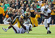 September 24, 2011: Iowa Hawkeyes running back Marcus Coker (34) is hit by Louisiana Monroe Warhawks linebacker Jason Edwards (54) on a run during the first quarter of the game between the Iowa Hawkeyes and the Louisiana Monroe Warhawks at Kinnick Stadium in Iowa City, Iowa on Saturday, September 24, 2011. Iowa defeated Louisiana Monroe 45-17.