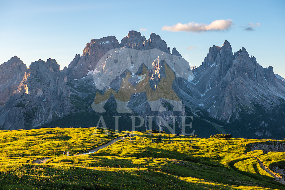 A wide angle view of a couple of athletes as seen on a cold but sunny Summer morning, hiking on Monte Piana, South Tyrol, Italy.