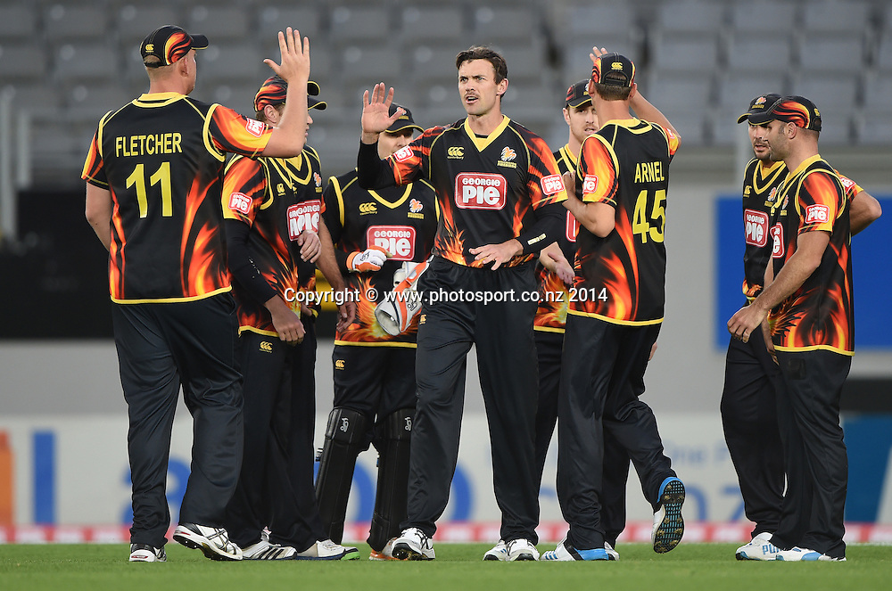 James Franklin and team mates celebrate a wicket during the Georgie Pie Super Smash Twenty20 cricket match between the Auckland Aces and Wellington Firebirds at Eden Park, Auckland on Friday 14 November 2014. Photo: Andrew Cornaga / www.Photosport.co.nz