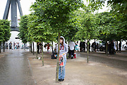 UNITED KINGDOM, London: 27-28 May 2017 A young visitor takes refuge from the rain under a tree outside of the convention.<br /> The comic convention, which will be visited by tens of thousands of comic book and cosplay fans, is being held at London's ExCel this weekend. Rick Findler / Story Picture Agency