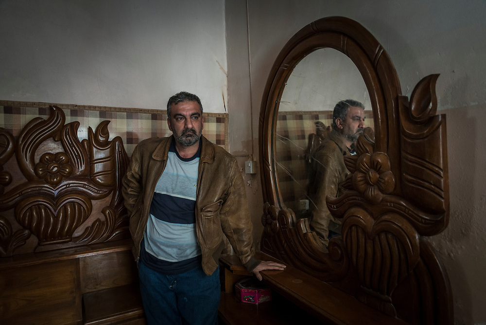 Father of five Safwan, 43, stands inside his home in the old city of Mosul, which was damaged extensively during the battle for liberation. &ldquo;Living here was hell,&rdquo; he explained, referring to the years he and his family lived in Mosul under ISIS occupation. &ldquo;They (ISIS) killed everyone. They destroyed everything.&rdquo;<br />