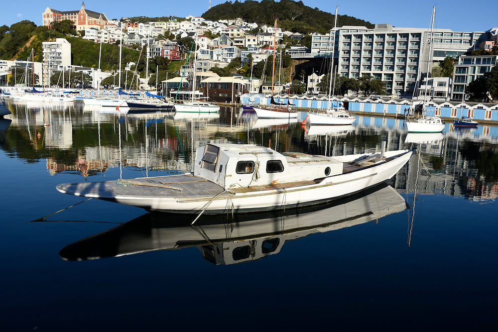 The small marina at Wellington, on a calm day with reflections of the yachts, boats and masts in the water
