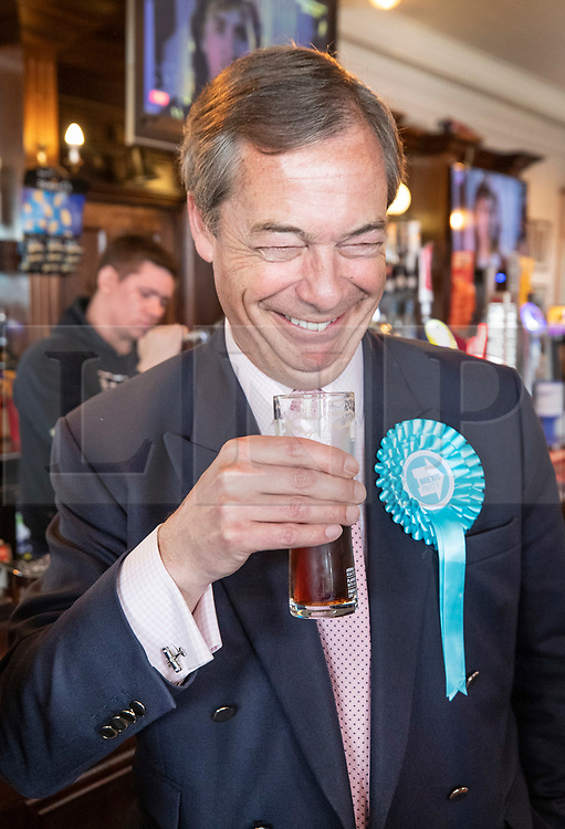 © Licensed to London News Pictures. 18/05/2019. Canvey Island, UK. Brexit Party leader Nigel Farage enjoys a half pint of bitter in The Monico pub as he campaigns for the European Elections in Canvey Island, Essex. The European Elections are being held on Thursday 23rd May. Photo credit: Peter Macdiarmid/LNP