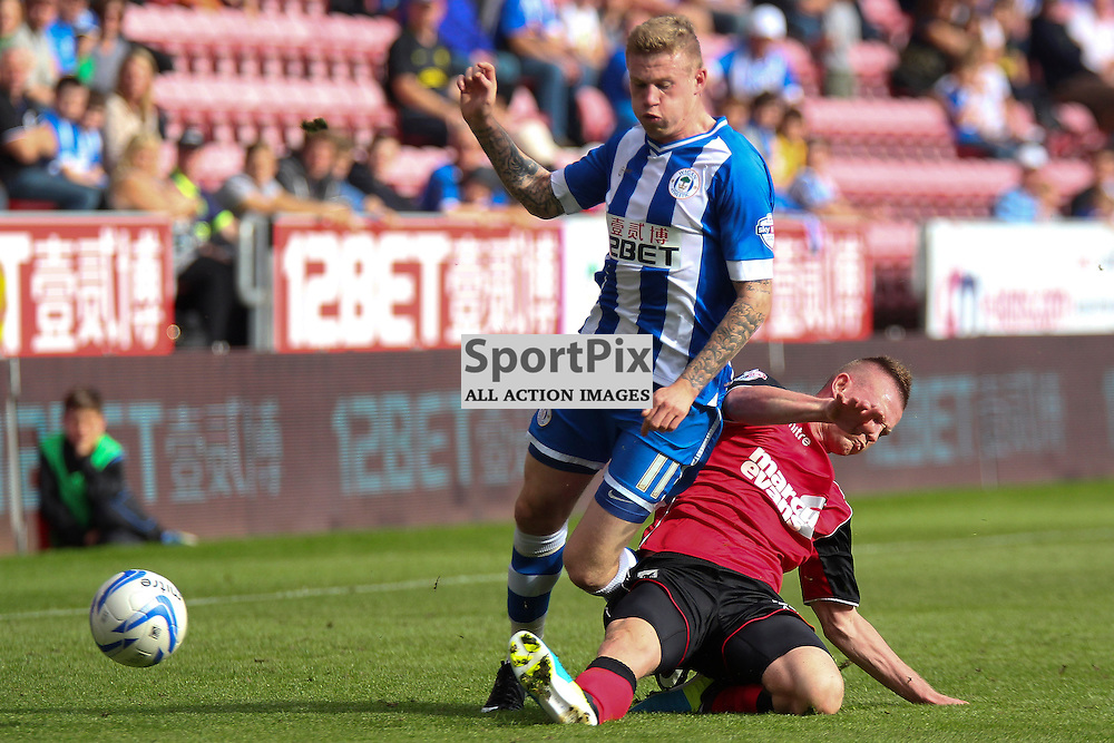 Ryan Tunnicliffe of Ipswich (r) makes the tackle on Wigan's James McClean (l), Wigan Athletic vs Ipswich Town, SkyBet Championship, 22nd September 2013 (c) Thomas Miller | SportPix.org.uk