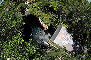 Sinkhole cliff diving competition held in Mexico<br /> <br /> Daredevil athletes have jumped from the edge of a 90ft deep sinkhole in a remote part of Mexico, as part of a cliff diving contest.<br /> Divers in the 'Cliff Diving World Series' performed stunts and reached speeds of 40mph before hitting the dark water of Cenote Ik Kil.<br /> Gary Hunt, from Southampton was the overall winner and managed to pull off a Triple Quad – one of the most difficult dives in the world.<br /> The Red Bull event lasted for two days -- though most of that time was probably taken up trying to get back out after each jump. <br /> Gary scored 373.85 and edged out second-placed Silchenko by a little over 10 points, with 2009 champion Duque taking third place.<br /> <br /> Photo Shows: Artem Silchenko of Russia dives from the 27.2 metre platform during round two of the 2010 Red Bull Cliff Diving World Series, Cenote Ik Kil, Yucatan, Mexico on June 05; 2010.<br /> (©Ray Demski/Exclusivepix)