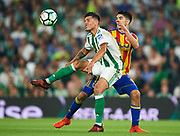 SEVILLE, SPAIN - OCTOBER 15:  Juanjo Narvaez of Real Betis Balompie (L) competes for the ball with Carlos Soler of Valencia CF (R) during the La Liga match between Real Betis and Valencia at Estadio Benito Villamarin on Octob  (Photo by Aitor Alcalde Colomer/Getty Images)