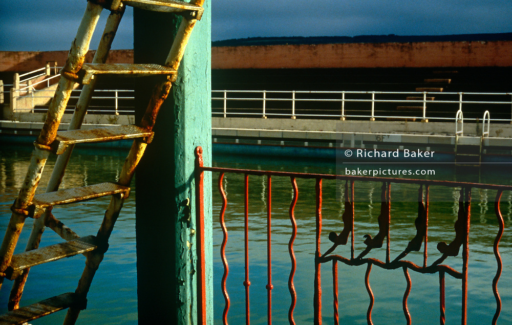 Original wrought iron features are rusting in the old lido (now demolished) that was a main attraction for generations in Minehead.