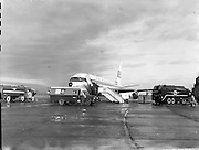 """06/12/1960<br /> 12/06/1960<br /> 06 December 1960<br /> Inaugural flight of new Irish Boeing Jetliner """"Padraig"""" to New York from Dublin Airport. Image shows the jet being fuelled by Esso fuel tankers at Dublin Airport."""