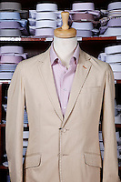 Suit on tailor's dummy at store