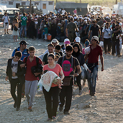 Refugees cross into Macedonia from Greece near Gevgelija on their way north to other European states on August 24, 2015. As soon as they cross the border, the refugees are sent to the northern border with Serbia in train or buses. Everyday approximately 3000 refugees cross into Macedonia.