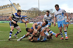 Anthony Watson of Bath Rugby looks to touch the ball down for a try but is stopped by Sean Maitland of Glasgow Warriors - Photo mandatory by-line: Patrick Khachfe/JMP - Mobile: 07966 386802 25/01/2015 - SPORT - RUGBY UNION - Bath - The Recreation Ground - Bath Rugby v Glasgow Warriors - European Rugby Champions Cup