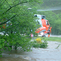River Almond, Crieff Perthshire Flooding Rescue.  19.06.05<br />A collect photograph of the stranded campers being rescued.  BEST QUALITY AVAILABLE<br />Picture by Graeme Hart.<br />Copyright Perthshire Picture Agency<br />Tel: 01738 623350  Mobile: 07990 594431