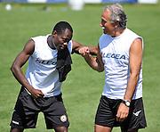 Arta Terme (UD), 27/07/2011.Campionato di calcio Serie A 2011/2012.Badu gioca con il DS Fabrizio Larini..© foto di Simone Ferraro