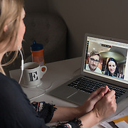 FORT MYERS, FLORIDA, JANUARY 29, 2017<br /> Erin Fahs, 33, uses her computer to have a conference call with interns Alex Spassov Simeonov and Ifigenia Papathanassis for the company she works for called The Collective Good which does consulting for non profit organizations. Fahs works from her home and got her job using a new company called Werk which connects employees with high level jobs. <br /> (Photo by Angel Valentin/Freelance)