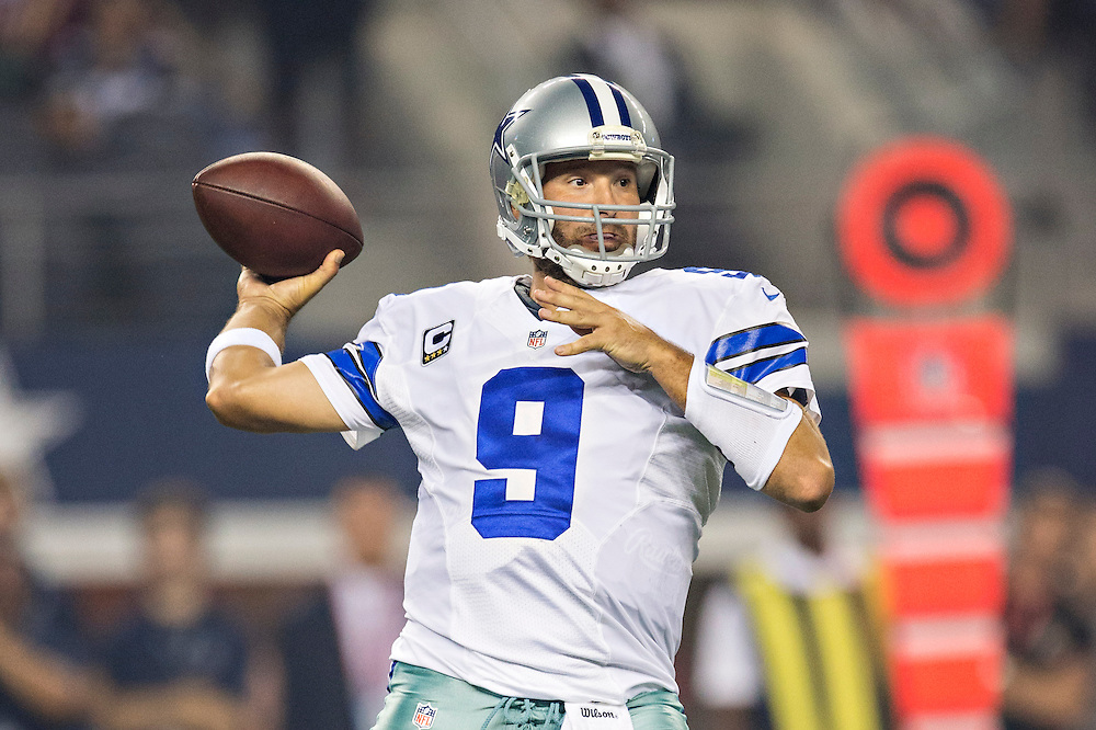 ARLINGTON, TX - OCTOBER 13:  Tony Romo #9 of the Dallas Cowboys throws a pass against the Washington Redskins at AT&T Stadium on October 13, 2013 in Arlington, Texas.  The Cowboys defeated the Redskins 31-16.  (Photo by Wesley Hitt/Getty Images) *** Local Caption *** Tony Romo