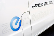 Photo shows the side of a prototype of Nissan's e-NV200 electric vehicle during a test run at the automaker's Oppama test circuit in Yokohama, Japan on 17 Oct. 2012.  Photographer: Robert Gilhooly