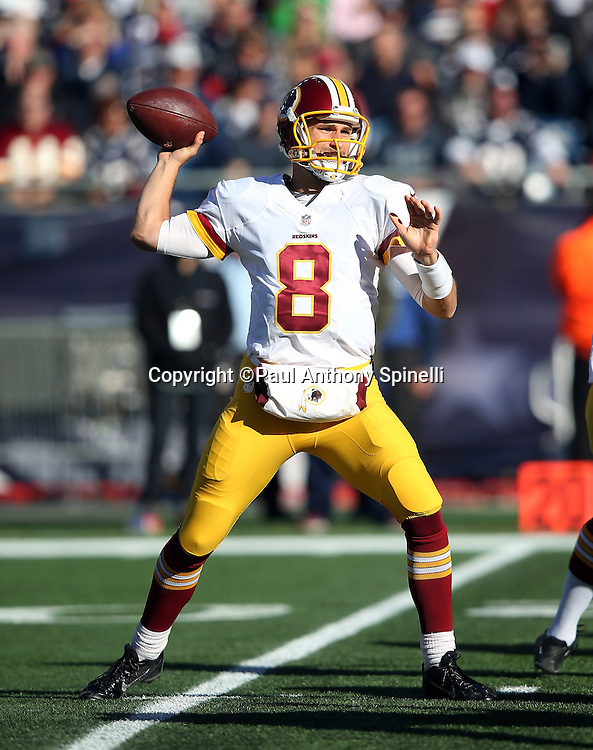Washington Redskins quarterback Kirk Cousins (8) throws a first quarter pass that gets intercepted by the New England Patriots during the 2015 week 9 regular season NFL football game against the New England Patriots on Sunday, Nov. 8, 2015 in Foxborough, Mass. The Patriots won the game 27-10. (©Paul Anthony Spinelli)