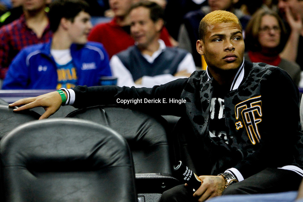 Jan 19, 2013; New Orleans, LA, USA; Former LSU Tigers cornerback Tyrann Mathieu watches courtside during  the second half of a game between the New Orleans Hornets and the Golden State Warriors at the New Orleans Arena. The Warriors defeated the Hornets 116-112. Mandatory Credit: Derick E. Hingle-USA TODAY Sports