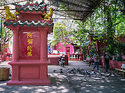 11 APRIL 2012 - HO CHI MINH CITY, VIETNAM:  The entry way of the Jade Emperor Pagoda in Ho Chi Minh City, Vietnam. It was built in 1909 by a Cantonese (Quang Dong) Congregation. It is one of the most colourful pagodas in HCMC, filled with statues of phantasmal divinities and grotesque heroes. Smoke of burning joss sticks fills the air, obscuring the exquisite woodcarvings decorated with gilded Chinese characters. The roof is covered with elaborate tile work, while the statues, which represent characters from both the Buddhist and Taoist traditions, are made of reinforced papier-mâché. The pagoda is dedicated to the Emperor of Jade, the supreme Taoist god. Ho Chi Minh City, formerly Saigon, is the largest city in Vietnam and the country's commercial center. It was the capital of South Vietnam before the reunification in 1975 and still shows more signs of American influence than northern Vietnam does.    PHOTO BY JACK KURTZ