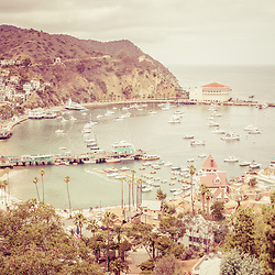 Avalon California Catalina Island retro photo. Santa Catalina Island Avalon Bay from above with the Avalon Casino, Avalon Pier, Holly Hill House, and the Avalon waterfront along the Pacific Ocean. High resolution picture has vintage nostalgic tone.