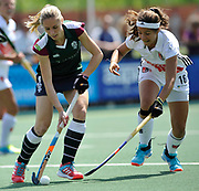 Surbiton's Jo Hunter challenges with Amsterdam's  Noor de Baat during the bronze medal match at the EHCC 2017 at Den Bosch HC, The Netherlands, 5th June 2017