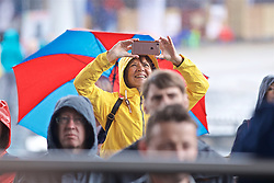CARDIFF, WALES - Wednesday, May 29, 2019: A supporter braves the rain to take a photograph during a Q&A with the Wales manager Ryan Giggs on the steps of the Senedd after a press conference at the Wales Millennium Centre during the Urdd National Eisteddfod to announce the squad for the forthcoming UEFA Euro 2020 Qualifying Group E matches for Wales against Croatia and Hungary. (Pic by David Rawcliffe/Propaganda)