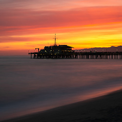Santa Monica Pier sunset panorama photo along the Pacific Ocean in Southern California. Copyright ⓒ 2017 Paul Velgos with All Rights Reserved.