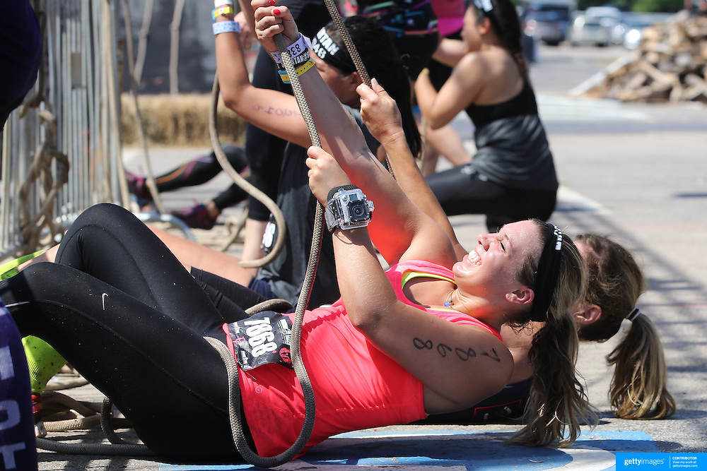 Stephanie Gambino in action at the Herculean Hoist obstacle during the Reebok Spartan Race. Mohegan Sun, Uncasville, Connecticut, USA. 28th June 2014. Photo Tim Clayton