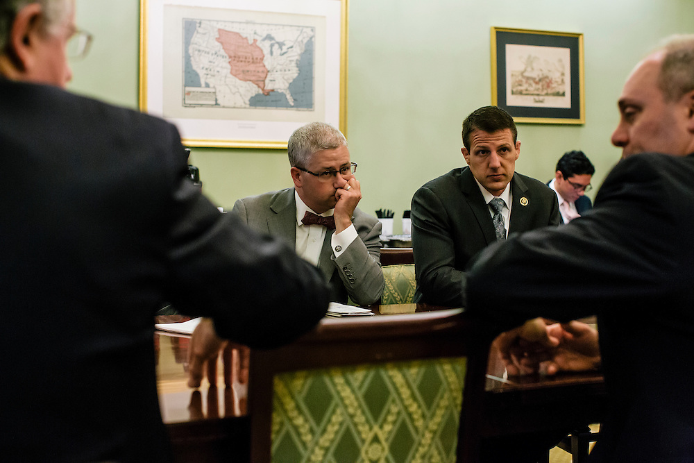 U.S. Rep. Patrick McHenry (R-N.C.), the chief deputy whip of House Republicans, talks with fellow republicans, including Markwayne Mullin of Oklahoma, right, at a weekly deputy whip meeting at the U.S. Capitol on April 23, 2015. McHenry is considered one of the fastest-rising stars of House Republicans.