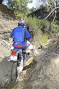 Roger Eggers on BMW HP2 descending steep slop during pit competition at 2010 Rawhyde Adventure Rider Challenge