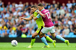 James Chester of Aston Villa closes down Jake Forster-Caskey of Rotherham United - Mandatory by-line: Dougie Allward/JMP - 13/08/2016 - FOOTBALL - Villa Park - Birmingham, England - Aston Villa v Rotherham United - Sky Bet Championship