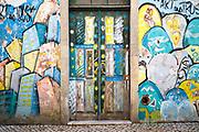 Street art on walls and door in Aveiro, Portugal