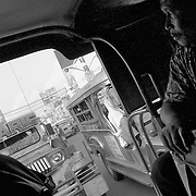 Taking a ride inside of a Jeepney through suburban streets of Metro Manila. Jeepneys are often colorful and always crowded and is the most popular means of mass transportation in the Philippines; they are made over from US military jeeps left behind after WWII.