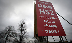 © Licensed to London News Pictures. 27/01/2012. Little Missenden, UK. An anti HS2 (High Speed Rail 2) sign near the village of Little Missenden, Buckinghamshire. Scheduled to be completed by 2033, the new Rail system will have huge effects on the chocolate box English village. Photo credit : Ben Cawthra/LNP