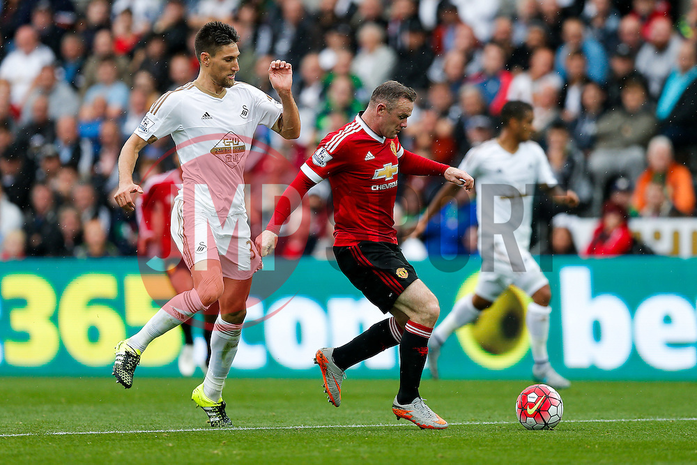 Wayne Rooney of Manchester United is challenged by Federico Fernandez of Swansea City - Mandatory byline: Rogan Thomson/JMP - 07966 386802 - 30/08/2015 - FOOTBALL - Liberty Stadium - Swansea, Wales - Swansea City v Manchester United - Barclays Premier League.