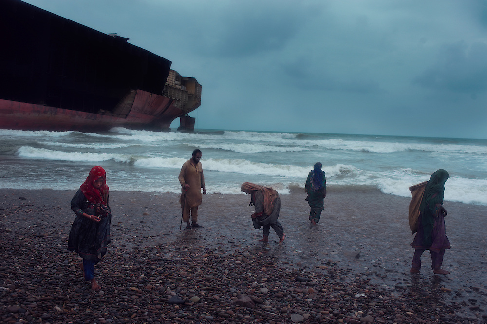 Women search in shallow waters for scrap metal at the Gadani Ship Breaking Yard, Balochistan Province, Pakistan on August 16, 2011.