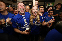 © Licensed to London News Pictures. 02/05/2016. Leicester, UK. Leicester City fans watching Chelsea vs Tottenham Hotspur game at a pub in Leicester city centre on Monday, 2 May 2016. Leicester City will claim the Premier League title if Tottenham fail to win at Stamford Bridge. Photo credit: Tolga Akmen/LNP