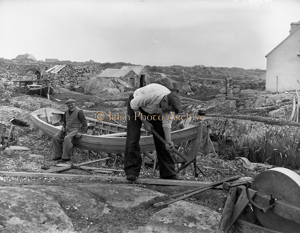 Carna.  Boat Bulding with the Cloherty family..14/05/1959<br /> 86 year old Peter Clogherty rests while his son Marcin works on raw timber.