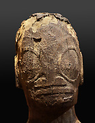 Head of a tiki statue in tuff, 54cm tall, from the Butteaud collection, acquired in 1928, in the Musee de Tahiti et des Iles, or Te Fare Manaha, at Punaauia, on the island of Tahiti, in the Windward Islands, Society Islands, French Polynesia. Tuff is a compressed volcanic ash, which was carved and then rubbed with pumice to create a smooth surface. Tikis are protective statues representing Ti'i, a half-human half-god ancestor who is believed to be the first man. The Museum of Tahiti and the Islands was opened in 1974 and displays collections of nature and anthropology, habitations and artefacts, social and religious life and the history of French Polynesia. Picture by Manuel Cohen