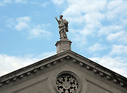 The San Stae church in Venice, Italy. Located in the Santa Croce quarter in the centre of the city. Photographed from the Grand Canal, showing the sculptural features on the architecture.