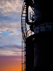 United States, Washington, Seattle. Sunset light behind a decommissioned natural gas refinery in Gassworks Park, Seattle, Washington.