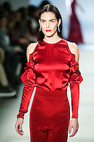 Hilary Rhoda walks the runway wearing Cushnie et Ochs Fall 2016, hair by Antonio Corral Calero for Moroccanoil, makeup by Val Garland, photographed by Thomas Concordia during New York Fashion Week on February 12, 2016