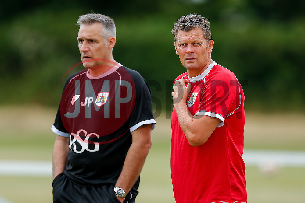 Manager Steve Cotterill (R) and first team coach John Pemberton look on as Bristol City return to training ahead of their 2015/16 Sky Bet Championship campaign - Photo mandatory by-line: Rogan Thomson/JMP - 07966 386802 - 01/07/2015 - SPORT - Football- Bristol, England - Failand Training Ground - Sky Bet Championship.
