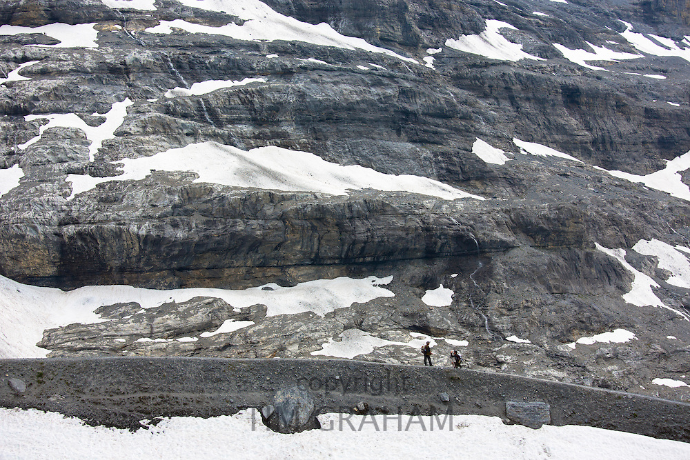 Hikers on the Eiger Trail near the Eiger Glacier, Eigergletscher, in Swiss Alps, Bernese Oberland, Switzerland