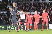 Derby County forward Wayne Rooney challenges Huddersfield Town goalkeeper Jonas Lössl for a loose ball during the EFL Sky Bet Championship match between Derby County and Huddersfield Town at the Pride Park, Derby, England on 15 February 2020.