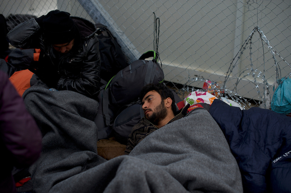 Migrants lay waiting the opening of the border post between Greece and Macedonia in Idomeni, Greece. Around 13,000 migrants and refugees, mostly from the Middle East and African nations, are believe to be stranded here awaiting a chance to proceed their journey towards Germany and other northern European countries.