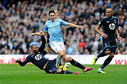 Tottenham Hotspur's Sandro challenges Manchester City's Samir Nasri inside the penalty box - Photo mandatory by-line: Dougie Allward/JMP - Tel: Mobile: 07966 386802 24/11/2013 - SPORT - Football - Manchester - Etihad Stadium - Manchester City v Tottenham Hotspur - Barclays Premier League